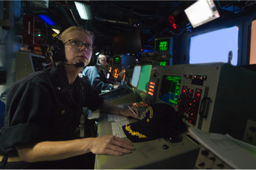 a technician aboard a naval ship at a computer